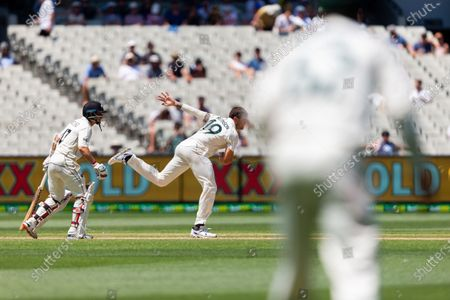 James Pattinson of Australia bowls during day four