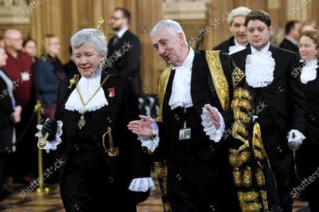 Stock Photo of Black Rod, Sarah Clarke, and Speaker of the House Lindsay Hoyle walk through the Central Lobby to hear the Queen's Speech, Houses of Parliament.