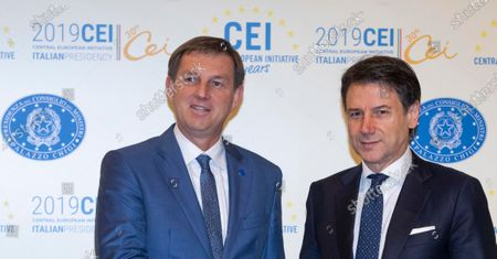 Italy's Prime Minister Giuseppe Conte (R) welcomes Slovenia's Deputy Prime Minister Miro Cerar prior to the start of the Summit of the Heads of Government of the Central European Initiative (CEI) at Farnesina Palace in Rome, 19 December 2019.