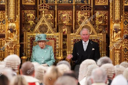 Britain's Queen Elizabeth II sits on the Sovereign's Throne next to Prince Charles before reading the Queen's Speech during the State Opening of Parliament at the Houses of Parliament