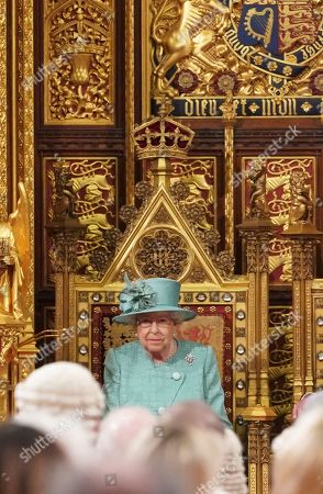 Britain's Queen Elizabeth II sits on the Sovereign's Throne before reading the Queen's Speech during the State Opening of Parliament at the Houses of Parliament