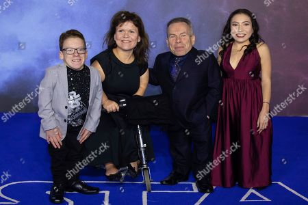 Stock Picture of Harrison Davis, Samantha Davis, Warwick Davis, Annabelle Davis. Harrison Davis, Samantha Davis, Warwick Davis and Annabelle Davis pose for photographers upon arrival at the premiere for the film 'Star Wars: The Rise of Skywalker', in central London