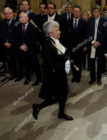Britain's Lady Usher of the Black Rod Sarah Clarke walks through the Commons Members Lobby in Parliament, in London, . Britain's parliament returns following the election, for the State Opening of Parliament
