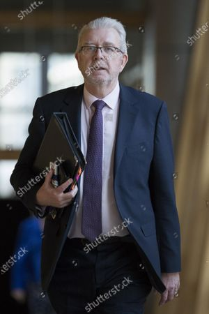 """Michael Russell, Cabinet Secretary for Government Business and Constitutional Relations or """"Brexit Minister"""", makes his way to the Debating Chamber."""