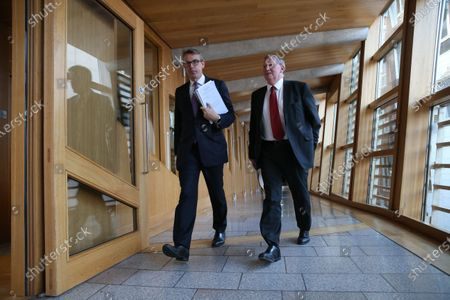 Stock Picture of Adam Tomkins and Alex Rowley, make their way to the Debating Chamber.