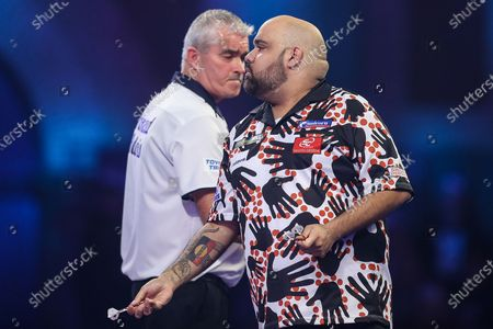Kyle Anderson and Steve Beaton during the PDC William Hill World Darts Championship at Alexandra Palace, London