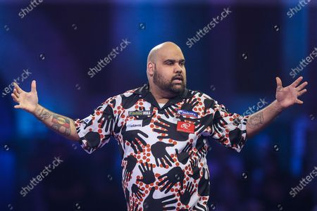 Stock Image of Kyle Anderson wins the first set and celebrates during the PDC William Hill World Darts Championship at Alexandra Palace, London
