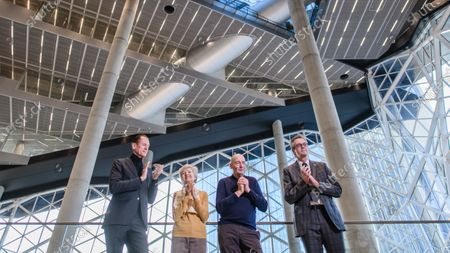 (L-R) Axel Springer CEO Mathias Doepfner, Axel Springer Supervisory Board Vice Chairwoman Friede Springer, Dutch architect Rem Koolhaas and Board member of Ed. Zueblin Joern Beckmann applaud during a hand-over of keys ceremony at the new Axel Springer building in Berlin, Germany, 19 December 2019. The construction of the new building, an architectural draft of Dutch architect Rem Kolhaas, started three ago in October 2016. From spring 2020 various parts of the Axel Springer publishing house, amongst them the WELT newspaper, shall reside in the new complex.