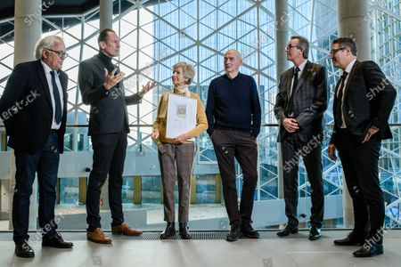 Axel Springer CEO Mathias Doepfner (2-L) speaks next to Axel Springer Supervisory Board Vice Chairwoman Friede Springer (3-L), President of German Sustainable Building Council (DNGB) Alexander Rudolphi (L), Dutch architect Rem Koolhaas (4-L), Board member of Ed. Zueblin Joern Beckmann (5-L) and Chief Executive Officer of German Sustainable Building Council (DNGB) Johannes Kreissig (R) during a hand-over of keys ceremony at the new Axel Springer building in Berlin, Germany, 19 December 2019. The construction of the new building, an architectural draft of Dutch architect Rem Kolhaas, started three ago in October 2016. From spring 2020 various parts of the Axel Springer publishing house, amongst them the WELT newspaper, shall reside in the new complex.