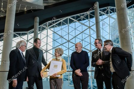 Axel Springer Supervisory Board Vice Chairwoman Friede Springer (3-L) talks to President of German Sustainable Building Council (DNGB) Alexander Rudolphi (L) and Axel Springer CEO Mathias Doepfner (2-L) next to Dutch architect Rem Koolhaas (4-L), Board member of Ed. Zueblin Joern Beckmann (5-L) and Chief Executive Officer of German Sustainable Building Council (DNGB) Johannes Kreissig (R) during a hand-over of keys ceremony at the new Axel Springer building in Berlin, Germany, 19 December 2019. The construction of the new building, an architectural draft of Dutch architect Rem Kolhaas, started three ago in October 2016. From spring 2020 various parts of the Axel Springer publishing house, amongst them the WELT newspaper, shall reside in the new complex.