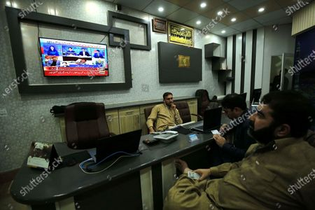 People watch a broadcast of the detailed verdict after sentencing former president Pervez Musharraf to death in high treason case in Peshawar, Pakistan, 19 December 2019. A Pakistan court on 17 December sentenced former president and military ruler Pervez Musharraf to death on charges of committing high treason in 2007 when he suspended the constitution and imposed a state of emergency. Musharraf, 76, has been living in Dubai since he was allowed to leave the country in March 2016 for medical treatment after a three-year travel ban.