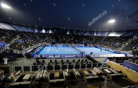 General view showing the tennis court at the Diriyah touristic site, in Riyadh Saudi Arabia, as Italian Fabio Fognini, left, plays with French Gael Sebastien Monfils. Prince Abdulaziz bin Turki al-Faisal, who leads the General Sports Authority, said during an interview with the Associated Press that he invites anyone who's interested or curious about Saudi Arabia to come and visit the country after it opened tourist visas to people from around the world three months ago