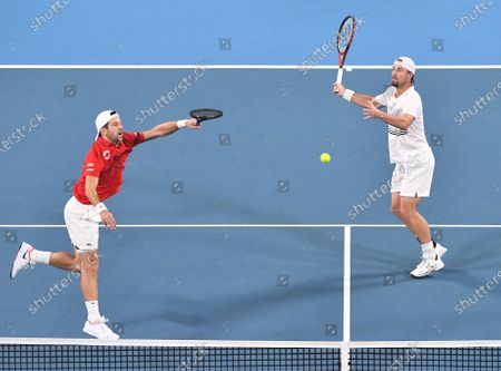 Oliver Marach and Jurgen Melzer of Team Austria in action during their men's doubles match