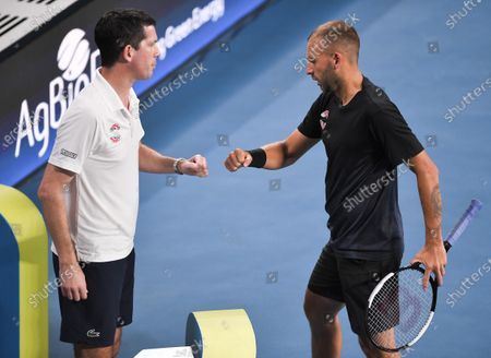 Daniel Evans of Team Great Britain greets Tim Henman during his men's singles match