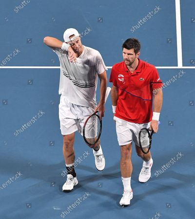 Jurgen Melzer and Oliver Marach of Team Austria in action during their men's doubles match