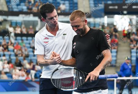 Tim Henman and Daniel Evans of Team Great Britain celebrate victory after Evans' men's singles match against Radu Albot of Team Moldova