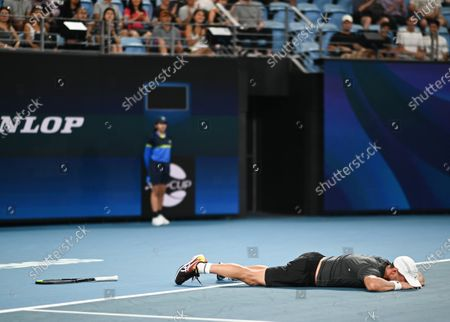 Dimitar Kuzmanov of Team Bulgaria collapses to the floor as he realises he has won his men's singles match against Steve Darcis of Team Belgium