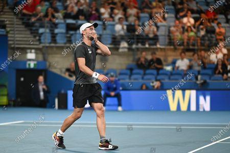 Dimitar Kuzmanov of Team Bulgaria celebrates victory after his men's singles match against Steve Darcis of Team Belgium
