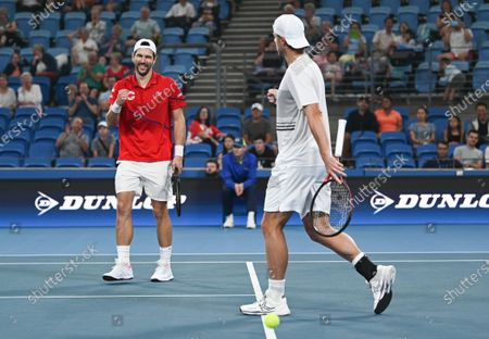 Jurgen Melzer and Oliver Marach of Team Austria celebrate victory after their men's doubles match Team Poland