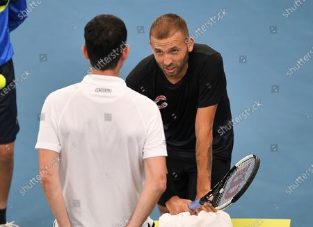 Stock Picture of Daniel Evans of Team Great Britain talking with Tim Henman during his quarter final singles match