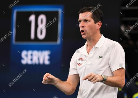Tim Henman speaking to Daniel Evans of Team Great Britain during his quarter final singles match