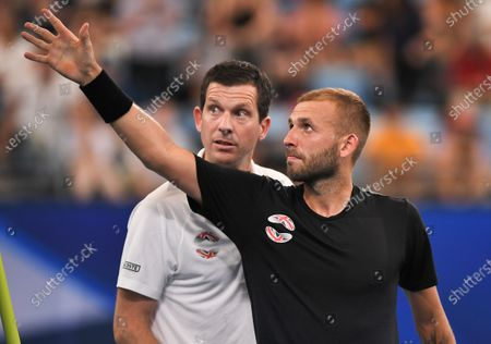 Daniel Evans of Team Great Britain celebrates victory with Tim Henman after his quarter final singles match against Alex de Minaur of Team Australia