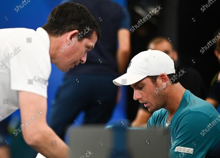 Cameron Norrie of Team Great Britain speaking with Tim Henman during his quarter final singles match