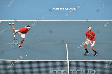 Stock Image of Adil Shamasdin and Peter Polansky of Team Canada in action during their quarter final doubles match