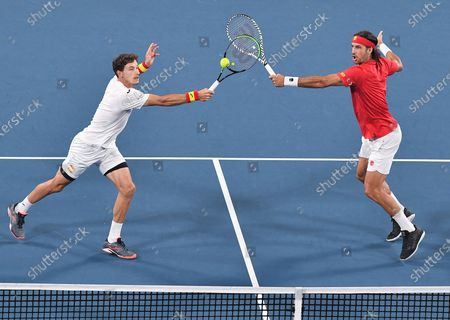 Pablo Carreno Busta and Feliciano Lopez of Team Spain in action during their doubles match in the final
