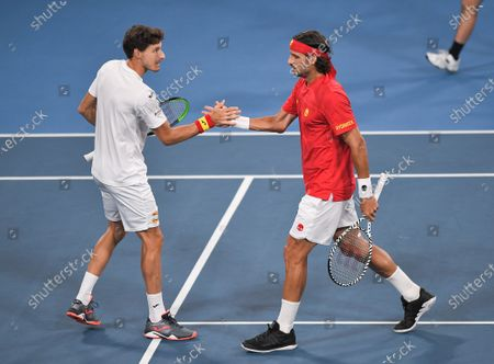 Pablo Carreno Busta and Feliciano Lopez of Team Spain celebrates during their doubles match in the final