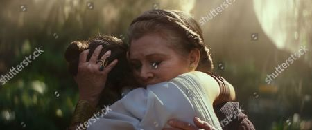 Daisy Ridley as Rey and Carrie Fisher as General Leia Organa