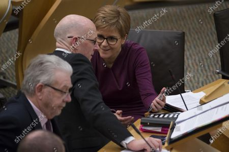 Referendums (Scotland) Bill - Nicola Sturgeon, First Minister of Scotland and Leader of the Scottish National Party (SNP), shares something on her smart phone with John Swinney, Deputy First Minister and Cabinet Secretary for Education and Skills.