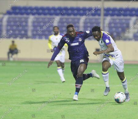 Al-Nassr's Ahmed Musa (R) in action against Al-Adalah's Nader Al Muwallad (L) during the Saudi Professional League soccer match between Al- Nassr and Al-Adalah at Prince Abdullah Bin Jalawi Stadium, Al-Ahsa, Saudi Arabia, 19 December 2019.