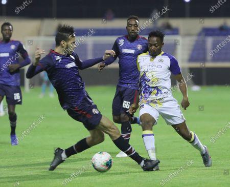 Al-Nassr's Ahmed Musa (R),  Al-Adalah's Nader Al Muwallad (C) and Al-Adalah's Abdulaziz Ali Guechi (L) in action during the Saudi Professional League soccer match between Al- Nassr and Al-Adalah at Prince Abdullah Bin Jalawi Stadium, Al-Ahsa, Saudi Arabia, 19 December 2019.