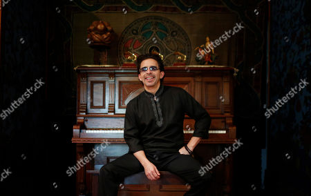 """This photo shows songwriter-producer George Noriega poses for a portrait in his studio in Davie, Fla. Noriega has produced Latin hits including Pedro Capo's """"Calma,"""" which last November won the Latin Grammy for song of the year"""