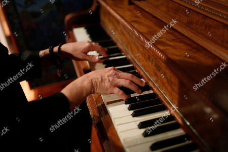 """This photo shows songwriter-producer George Noriega plays the piano in his studio in Davie, Fla. Noriega has produced Latin hits including Pedro Capo's """"Calma,"""" which last November won the Latin Grammy for song of the year"""