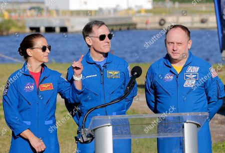 NASA astronaut Nicole Mann, left, gestures as Boeing astronaut Chris Ferguson, center, and NASA astronaut Mike Fincke look on during a press conference at the Kennedy Space Center, in Cape Canaveral, Fla., . They will be the first crew to fly on the Starliner spacecraft some time next year