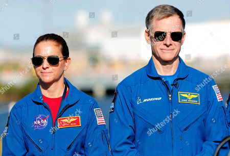 NASA astronaut Nicole Mann, left, and Boeing astronaut Chris Ferguson, look on during a press conference at the Kennedy Space Center, in Cape Canaveral, Fla., . They will be part of the first crew to fly on the Starliner spacecraft some time next year
