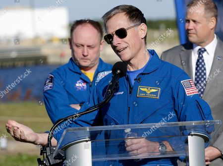 Boeing astronaut Chris Ferguson, center, speaks as NASA astronaut Mike Fincke and NASA administrator Jim Bridenstine look on during a press conference at the Kennedy Space Center, in Cape Canaveral, Fla., . Ferguson and Fincke will be part of the first crew to fly on the Starliner spacecraft some time next year