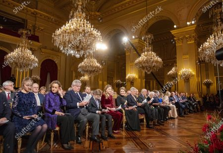Stock Photo of Queen Mathilde, King Philippe, Crown Princess Elisabeth, Prince Gabriel, Prince Emmanuel, Princess Eleonore, Princess Astrid, Prince Lorenz, King Albert II, Queen Paola, Princess Claire, Prince Laurent and Princess Louise during the traditional Christmas concert at the Royal Palace