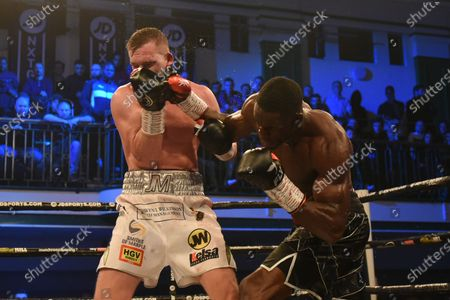 Stock Picture of Richard Riakporhe (black shorts) defeats Jack Massey during a Boxing Show at York Hall on 19th December 2019