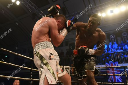 Stock Image of Richard Riakporhe (black shorts) defeats Jack Massey during a Boxing Show at York Hall on 19th December 2019
