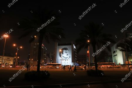An image of Sheikh Tamim bin Hamad Al Thani on the side of a building in Doha, Qatar
