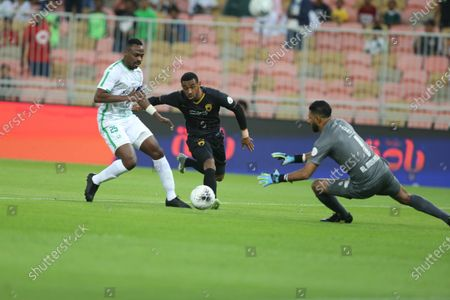 Stock Photo of AL-Ahly's Motaz Hawsawi (L) in action against Damac's Mouhssine Lajour (C) And AL-Ahly's Yasser Al Mosailem (R) during the Saudi Professional League soccer match between AL-Ahly and Damac at King Abdullah Sport City Stadium, Jeddah, Saudi Arabia, 19 December 2019.