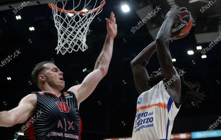 Valencia Baskets Maurice Ndour (R) drives up to the basket against  Ax Armani Exchange Milan?s Michael Roll during their Euroleague basketball match at the Assago Forum, Milan, Italy, 19 December  2019.