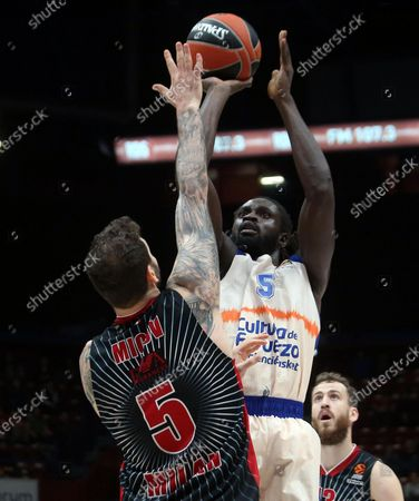 Valencia Baskets Maurice Ndour (R) drives up to the basket against  Ax Armani Exchange Milan?s Vladimir Micov during their Euroleague basketball match at the Assago Forum, Milan, Italy, 19 December  2019.
