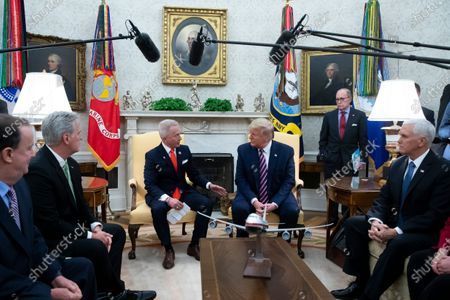 US President Donald Trump (C) meets with Representative Jeff Van Drew (2-L) of New Jersey, beside US Vice President Mike Pence (R), US House Minority Leader Republican Kevin McCarthy (L) and Director of the National Economic Council Larry Kudlow (Back C); the day after the US House of Representatives impeached Trump, in the Oval Office of the White House in Washington, DC, USA, 19 December 2019. Representative Jeff Van Drew of New Jersey was one of three Democrats that crossed party lines to oppose one or both of the impeachment articles passed in the House of Representatives. Van Drew has said he will switch to the Republican party.