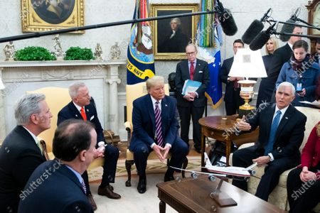 US President Donald Trump (C) listens to US Vice President Mike Pence (R) during a meeting with Representative Jeff Van Drew (2-L) of New Jersey, US House Minority Leader Republican Kevin McCarthy (L) and Director of the National Economic Council Larry Kudlow (Back C) the day after the US House of Representatives impeached Trump; in the Oval Office of the White House in Washington, DC, USA, 19 December 2019. Representative Jeff Van Drew of New Jersey was one of three Democrats that crossed party lines to oppose one or both of the impeachment articles passed in the House of Representatives. Van Drew has said he will switch to the Republican party.