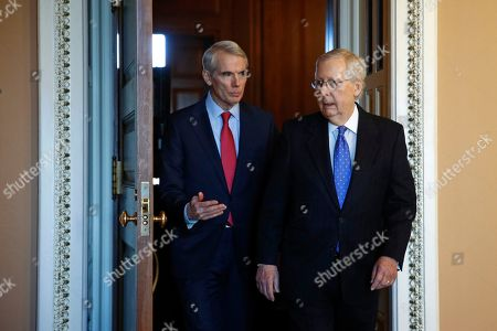 Stock Picture of Mitch McConnell, Rob Portman. Sen. Rob Portman, R-Ohio, left, talks with Senate Majority Leader Mitch McConnell of Ky., on Capitol Hill in Washington