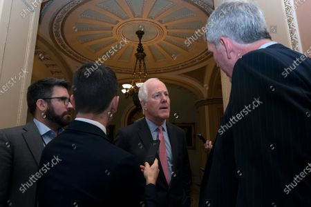 United States Senator John Cornyn (Republican of Texas) speaks to members of the media as he enters a Republican luncheon on Capitol Hill in Washington DC